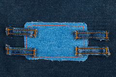 Frame made of denim with four straps of jeans Stock Photography