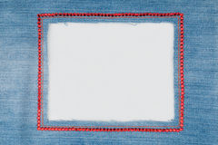 Frame is made from denim with red rhinestones  on a white background. Stock Images
