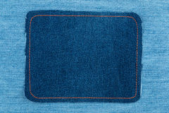 Frame made of denim with yellow stitching is on a light jeans Royalty Free Stock Photography