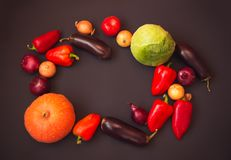 Frame made of different fresh vegetables on dark background. Top view, copy space stock images