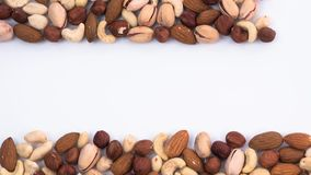 Frame made of different types of nuts. Stop motion stock video