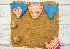 The frame is made of fabric and hearts. To print in the Internet and in the newspaper Royalty Free Stock Photos