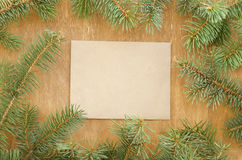 Frame made of fir branches and envelope for copyspace. Stock Photos