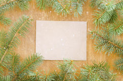 Frame made of fir branches and envelope for copyspace. Stock Photo
