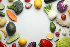 Frame made with fresh ripe vegetables and fruits on light background, flat lay. Space for text stock photos