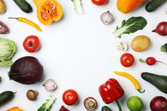 Frame made of fresh ripe vegetables on white background, flat lay. Space for text royalty free stock photo