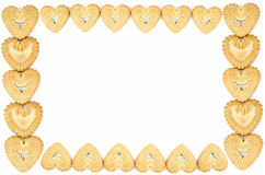 Frame made of heart shaped biscuits. Bakery - Frame made of heart shaped biscuits - Isolated on white - Abstract background Royalty Free Stock Images