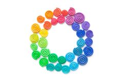 Frame made of plasticine. Twisted colored spirals of plastic of. Different colors stock photos