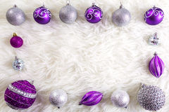 Frame made by purple and silver christmas baubles Royalty Free Stock Photos