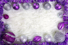 Frame made by purple and silver christmas baubles Stock Image