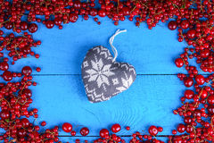 Frame made of red currant and cherry with heart shape Stock Photo