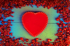 Frame made of red currant and cherry with red heart shape Royalty Free Stock Photography
