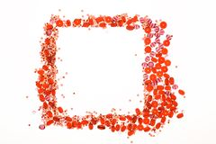 Frame made with red and pink beads. On white background Stock Photography