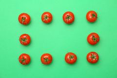 Frame made of ripe tomatoes. On color background Stock Photography