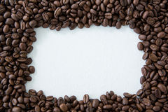 Frame made from roasted coffee beans. On white background Stock Photography