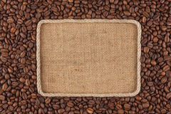 Frame  made of rope with  coffee beans  lying on sacking Stock Photography
