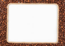 Frame made of rope with  coffee beans  lying on a white backgrou Stock Photo
