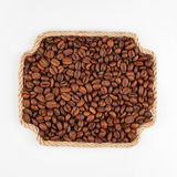 Frame made of rope with coffee  beans  lying on a white backgrou Royalty Free Stock Photos
