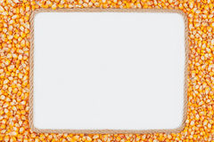 Frame made of rope with  corn  lying on a white background Stock Image