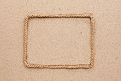 Frame made of rope lying on the sand Royalty Free Stock Photo