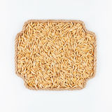 Frame made of rope with  oats  lying on a white background Stock Photography