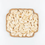 Frame made of rope with  pumpkin  seeds  lying on a white backgr Royalty Free Stock Image