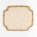 Frame made of rope with rice lying on a white background Royalty Free Stock Photos