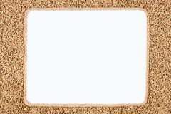 Frame made of rope with rye lying on a white background Royalty Free Stock Photo