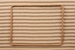 Frame made of rope  on the sand Royalty Free Stock Images