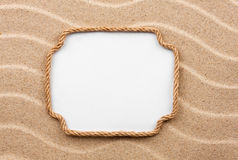 Frame made of rope with a white background on the sand Stock Photos