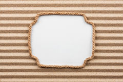Frame made of rope with a white background on the sand Stock Images