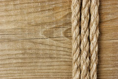 Frame made of rope on a wooden Royalty Free Stock Photo
