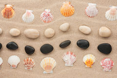 Frame made of seashell and stone on a wavy sand Royalty Free Stock Images