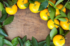 Frame made of tangerines and leaves.  Stock Photos