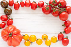 Frame made of tomatoes. Frame made of colorful tomatoes Stock Photos