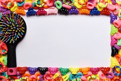 A frame made from a variety of brightly colored pins, rubber bands for hair and combs royalty free stock photos