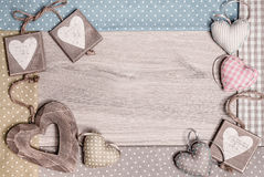 Frame made on wood with cotton and wooden hearts, text space Royalty Free Stock Image