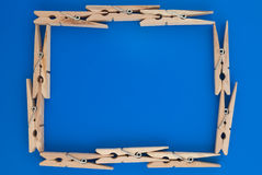 Frame made of wooden clothes pegs Stock Photos