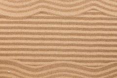 Frame made of zigzag on wavy sand. Stock Photos