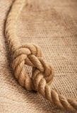 Frame make from rope laying on jute Royalty Free Stock Image