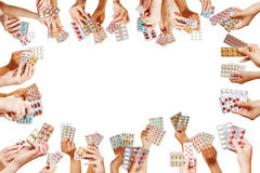 Frame of many hands with medical pills Royalty Free Stock Images