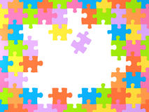 Frame with many miltu-colored puzzles Stock Images