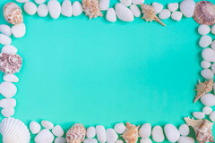 The frame in the marine style. Frame in a marine style with pebbles and seashells. The background color of the sea stock images