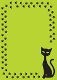 Frame met zwarte kat en kattenpoot op groene backgrou royalty-vrije illustratie