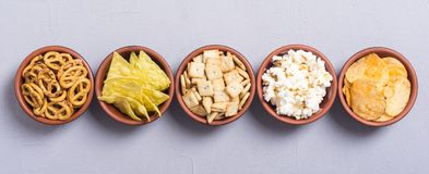 Mix of snacks. Frame . Mix of snacks : pretzels , crackers , chips nachos and pop corn stock images
