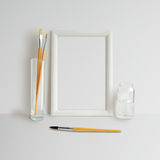 Frame Mock Up. Mock up with Frame and brushes on white background Royalty Free Stock Photo