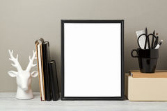 Frame mock up on table. Black frame mock up with pencil and notebook. Modern stylish interior background for social media and marketing Royalty Free Stock Photo