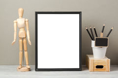 Frame mock up on table. Black frame mock up with pencils and dummy. Modern stylish interior background for social media and marketing Stock Image