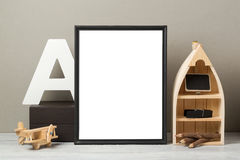Frame mock up on table. Modern workspace with blank frame mock up. Creative desk interior background for socila media and marketing Stock Image