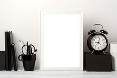 Frame mock up on table. White frame mock up with pencil and alarm clock. Modern stylish interior background for social media and marketing Royalty Free Stock Photos